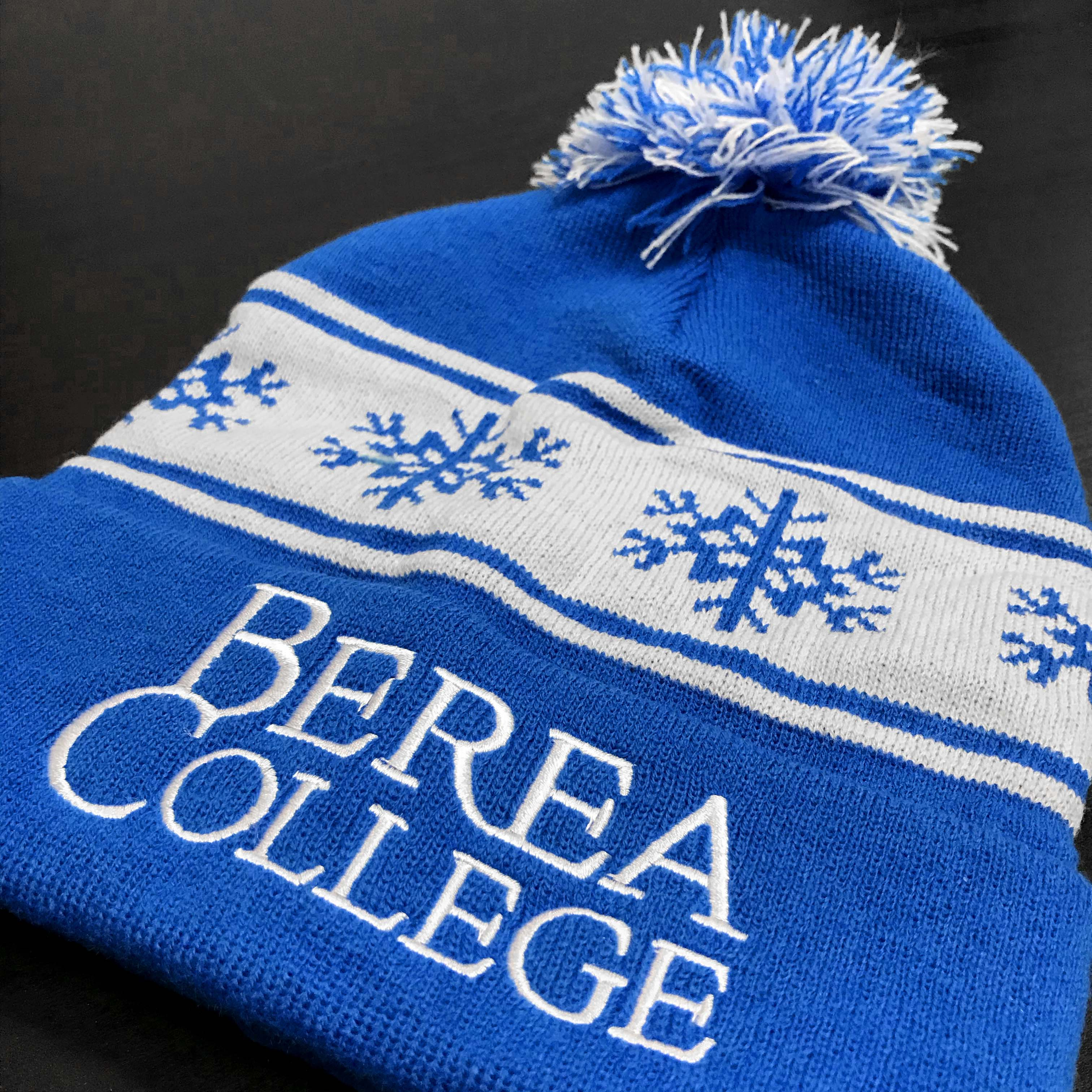 Berea College blue winter beanie with pompom.