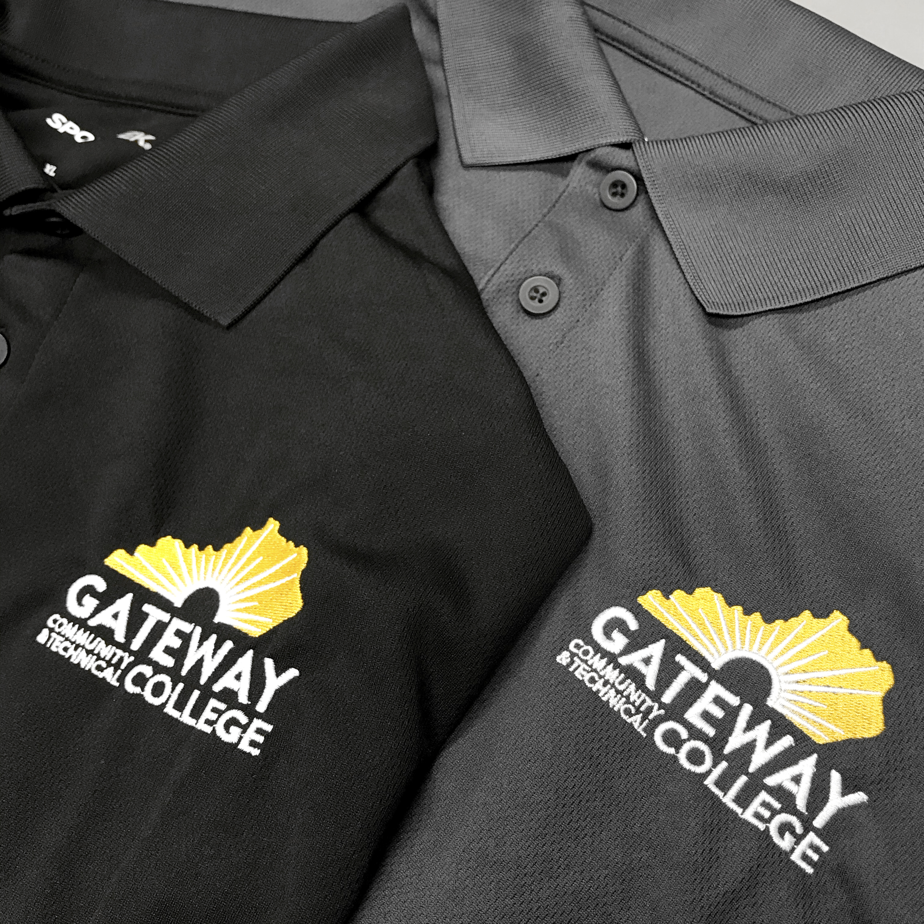 Gateway College gray and black polos.