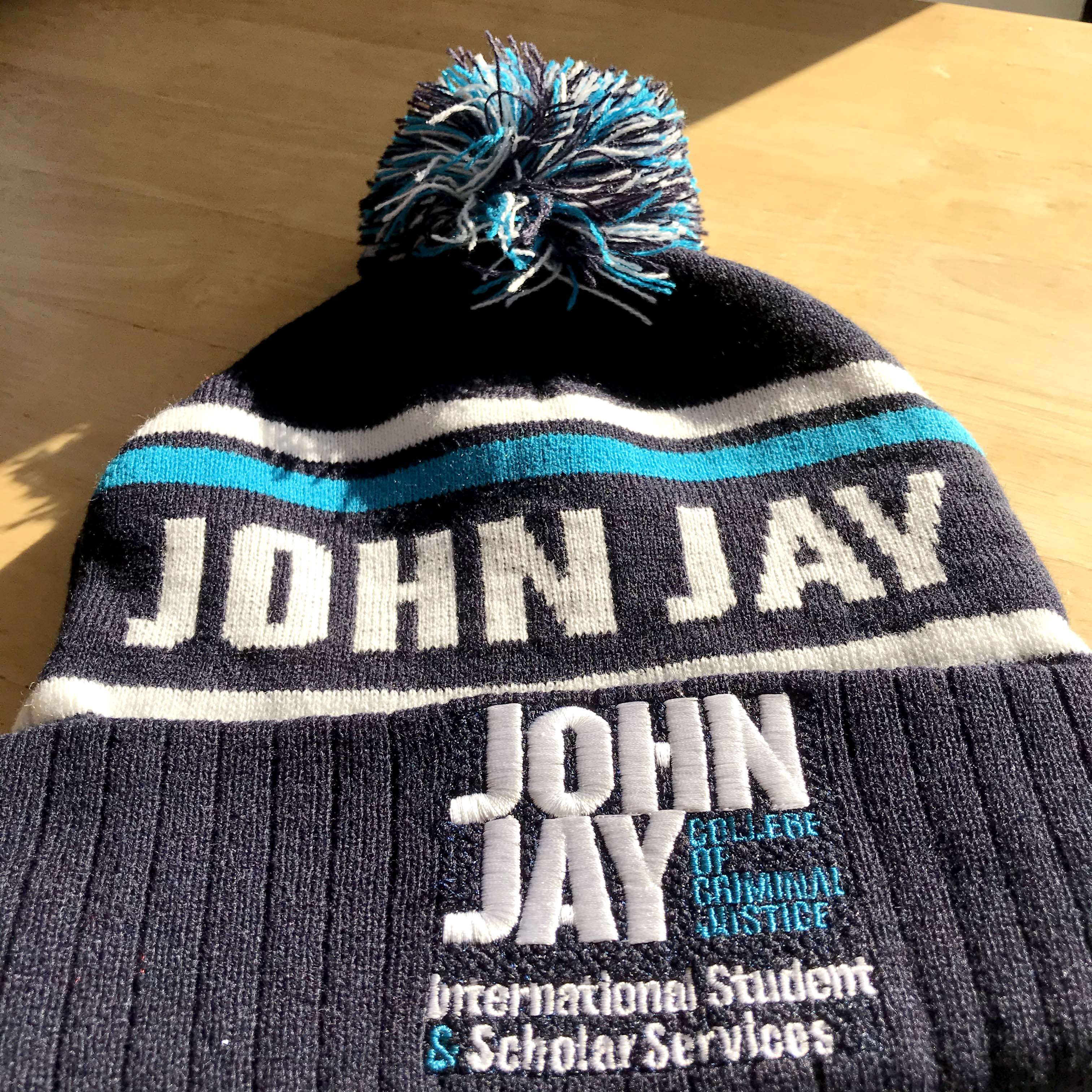 A John Jay black, blue and gray beanie.