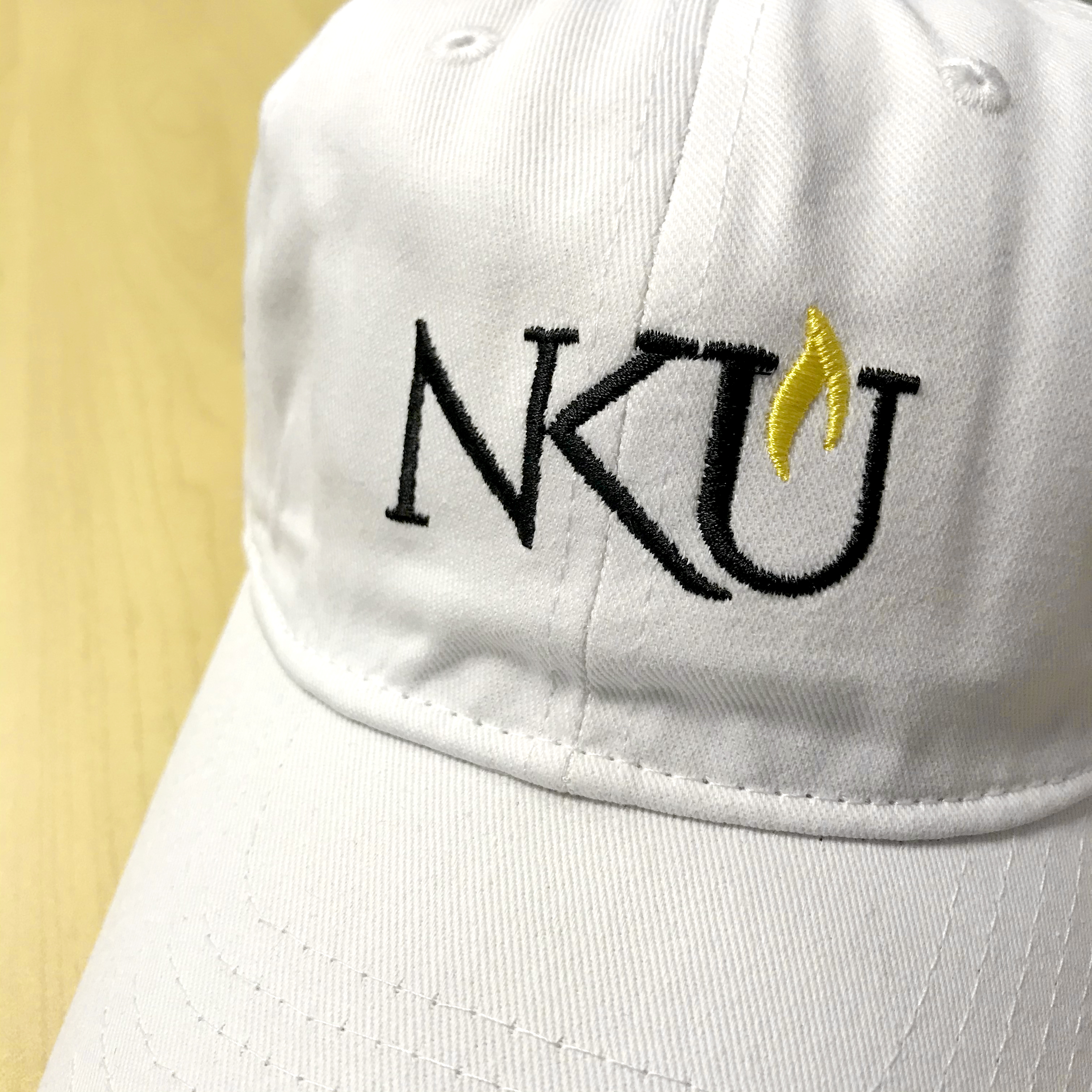 Baseball hat with NKU embroidered on the front.