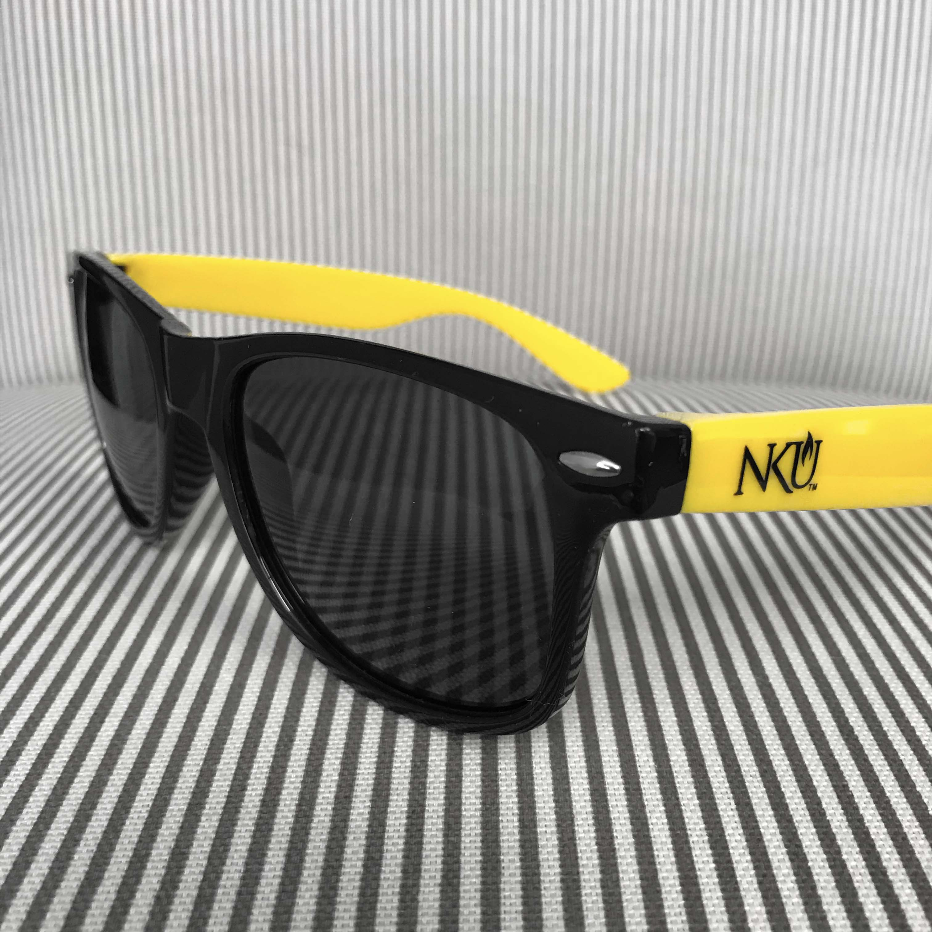 Yellow sunglasses with the NKU logo on the legs.