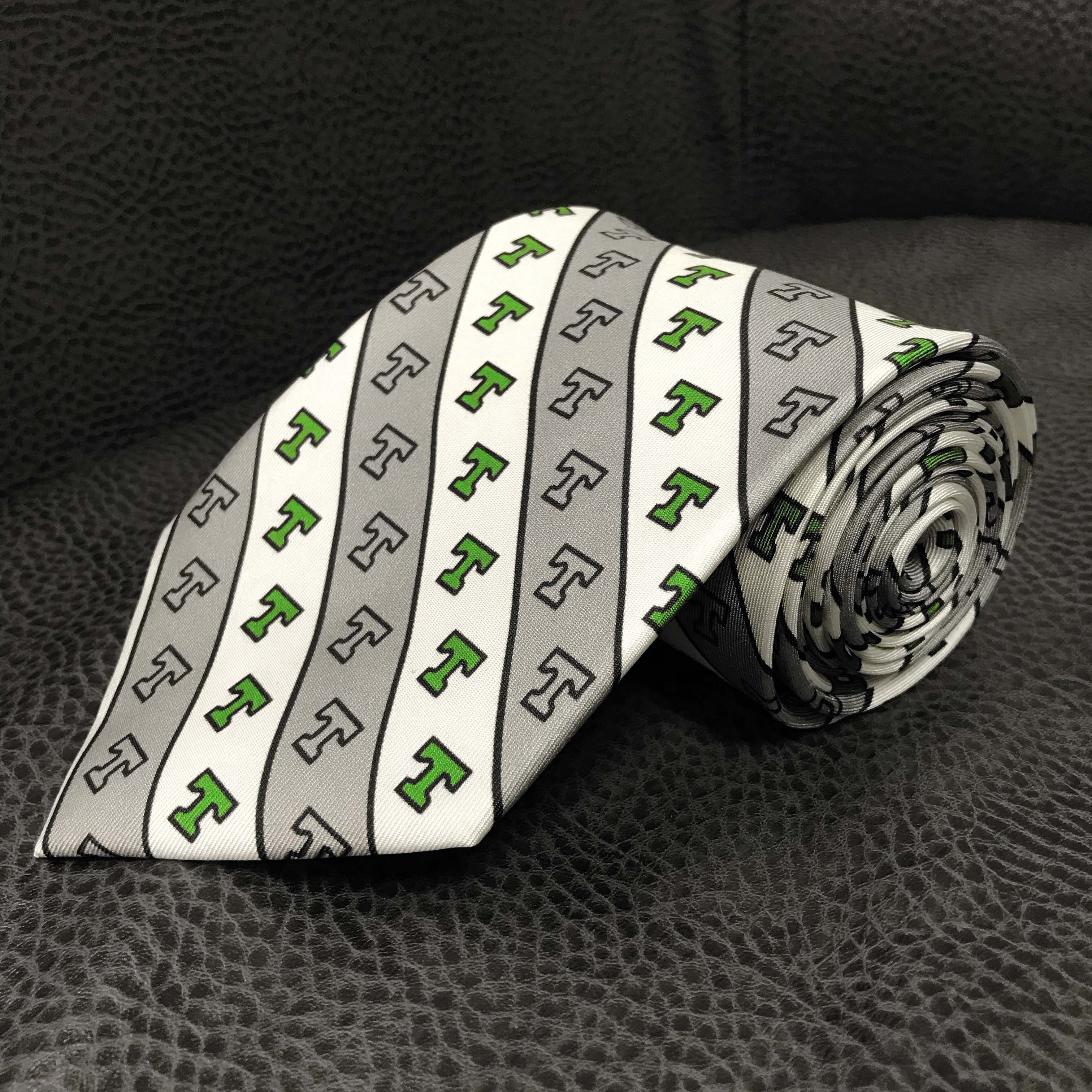 Custom decorated T gray tie.