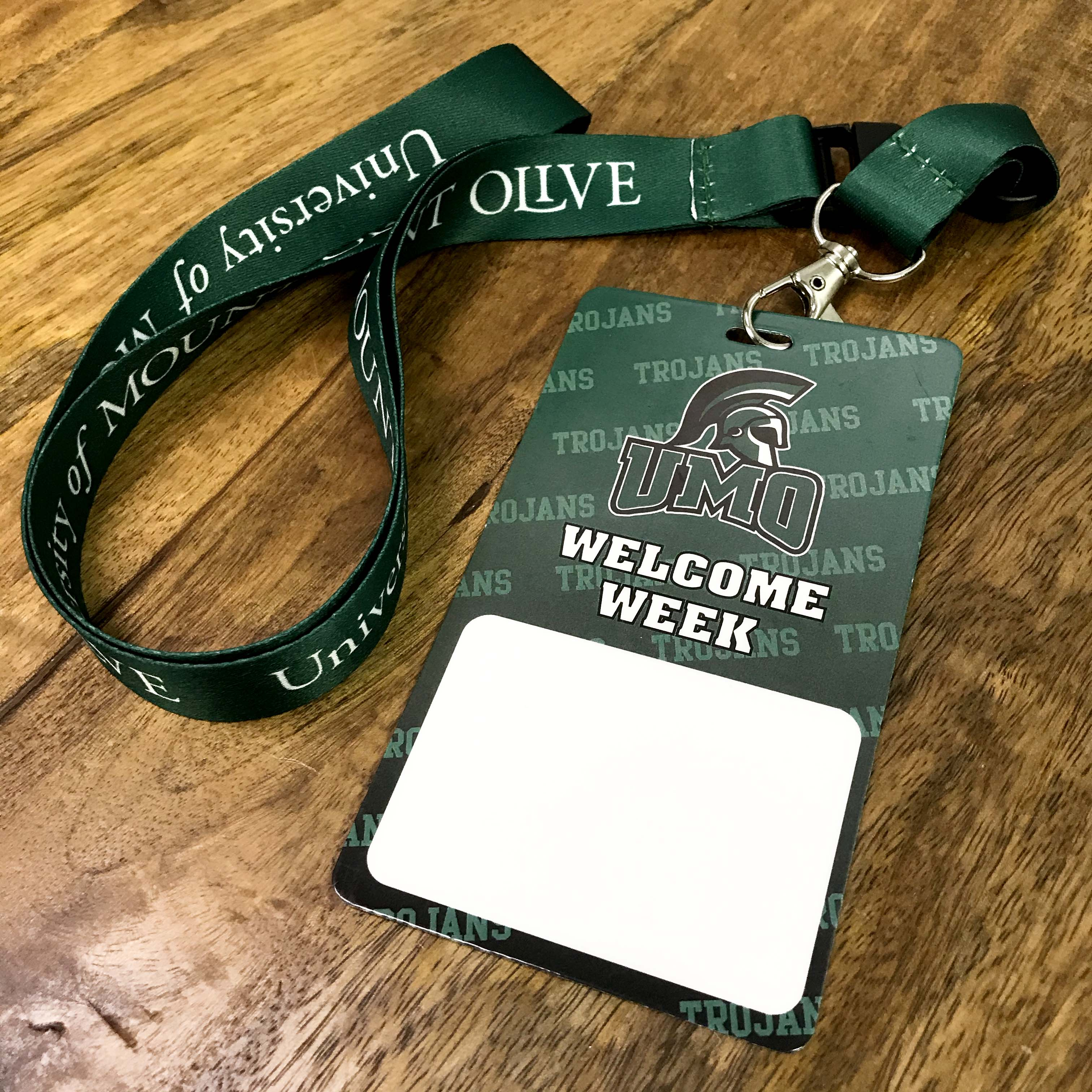 UMO Welcome Week badge and lanyard.